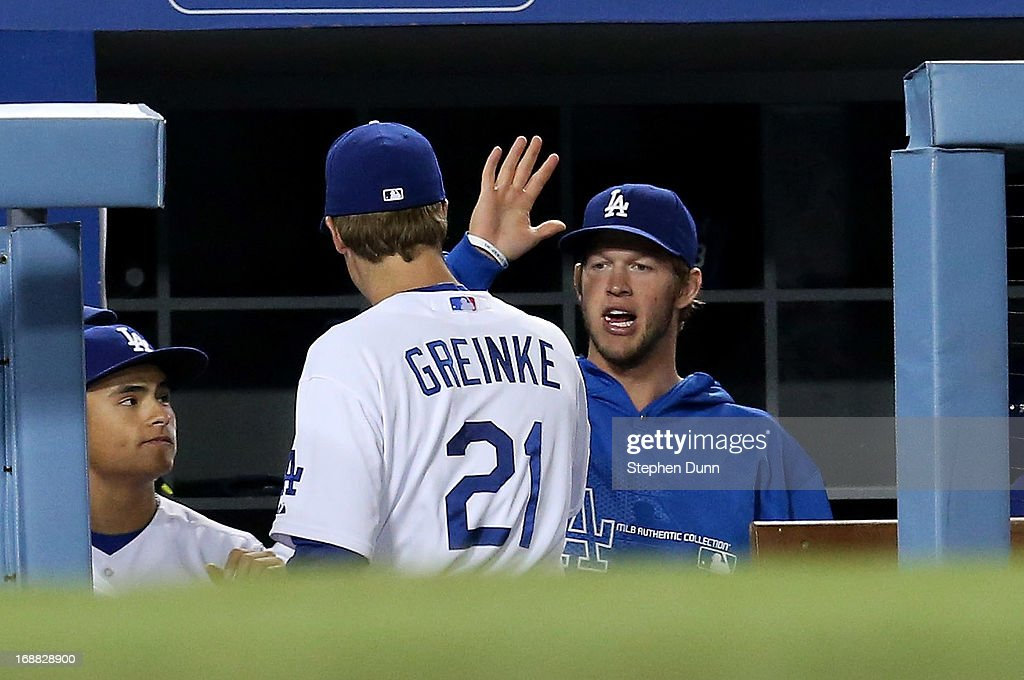 <a gi-track='captionPersonalityLinkClicked' href=/galleries/search?phrase=Zack+Greinke&family=editorial&specificpeople=212804 ng-click='$event.stopPropagation()'>Zack Greinke</a> #21 of the Los Angeles Dodgers is greeted in the dugout by <a gi-track='captionPersonalityLinkClicked' href=/galleries/search?phrase=Clayton+Kershaw&family=editorial&specificpeople=4391635 ng-click='$event.stopPropagation()'>Clayton Kershaw</a>#22 after being relieved in the sixth inning of the game against the Washington Nationals at Dodger Stadium on May 15, 2013 in Los Angeles, California.
