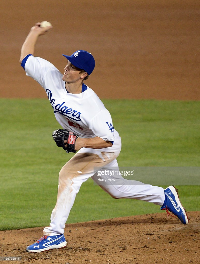 Zack Greinke #21 of the Los Angeles Dodgers pitches during the sixth inning against the Pittsburgh Pirates at Dodger Stadium on April 5, 2013 in Los Angeles, California.