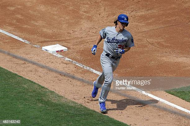 Zack Greinke of the Los Angeles Dodgers rounds third base after hitting a home run in the third inning during a game against the Philadelphia...