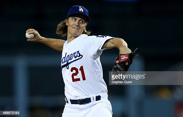 Zack Greinke of the Los Angeles Dodgers throws a pitch against the Pittsburgh Pirates at Dodger Stadium on September 18 2015 in Los Angeles California