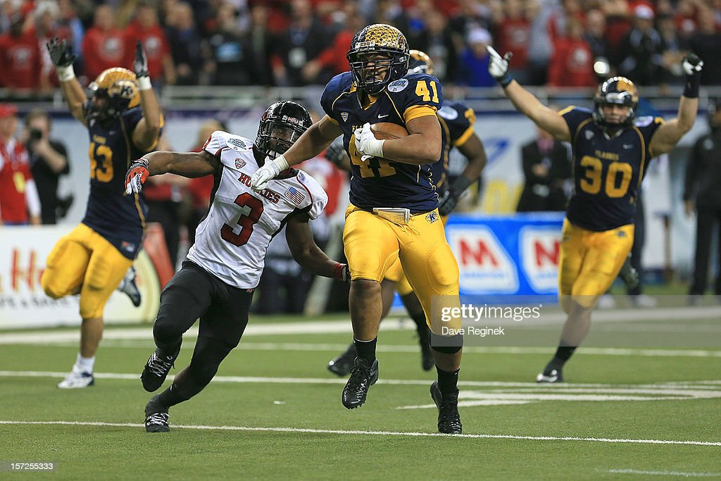 Zack Hitchens #41 of the Kent State Golden Flashes runs after picking up a fumble, chased by Akeem Daniels #3 of the Northern Illinois Huskies for second-half touchdown during the Mid-American Conference Championship game at Ford Field on November 30, 2012 in Detroit, Michigan. Illinois won 44-37