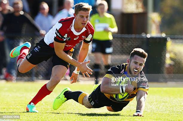 Zack Holmes of the Spirit scores a try during the round one National Rugby Championship match between the Canberra Vikings and Perth Spirit at Viking...