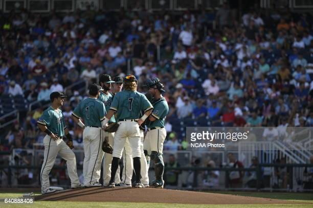 Zack Hopeck of Coastal Carolina University and teammates have a meeting on the mound against University of Arizona during the Division I Men's...