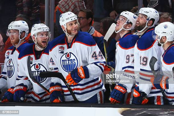 Zack Kassian Mark Letestu Connor McDavid and Patrick Maroon of the Edmonton Oilers celebrate an empty net goal in the third period against the...