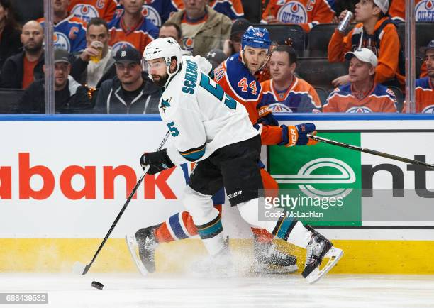 Zack Kassian of the Edmonton Oilers battles along the boards against David Schlemko of the San Jose Sharks in Game One of the Western Conference...