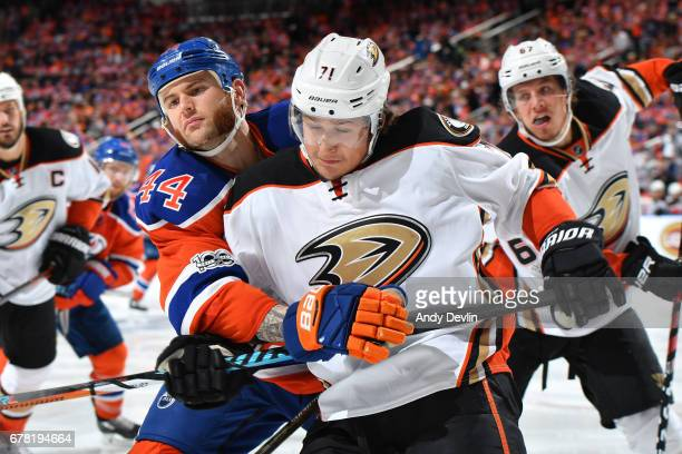 Zack Kassian of the Edmonton Oilers battles for the puck against Brandon Montour of the Anaheim Ducks in Game Four of the Western Conference Second...