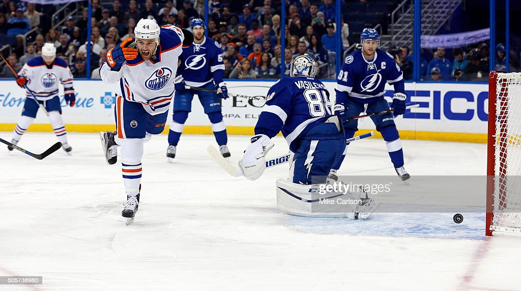 <a gi-track='captionPersonalityLinkClicked' href=/galleries/search?phrase=Zack+Kassian&family=editorial&specificpeople=4604939 ng-click='$event.stopPropagation()'>Zack Kassian</a> #44 of the Edmonton Oilers celebrates his goal against <a gi-track='captionPersonalityLinkClicked' href=/galleries/search?phrase=Andrei+Vasilevskiy+-+Ice+Hockey+Player&family=editorial&specificpeople=9594320 ng-click='$event.stopPropagation()'>Andrei Vasilevskiy</a> #88 of the Tampa Bay Lightning at the Amalie Arena on January 19, 2016 in Tampa, Florida.