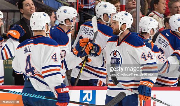 Zack Kassian of the Edmonton Oilers celebrates his secondperiod goal against the Ottawa Senators with team mate Taylor Hall during an NHL game at...