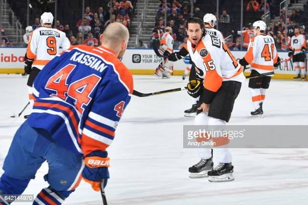 Zack Kassian of the Edmonton Oilers exchanges words with Michael Del Zotto of the Philadelphia Flyers on February 16 2017 at Rogers Place in Edmonton...