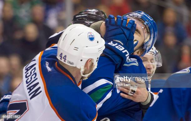 Zack Kassian of the Edmonton Oilers gets his glove in the face of Nikita Tryamkin of the Vancouver Canucks during a scuffle after the whistle in NHL...