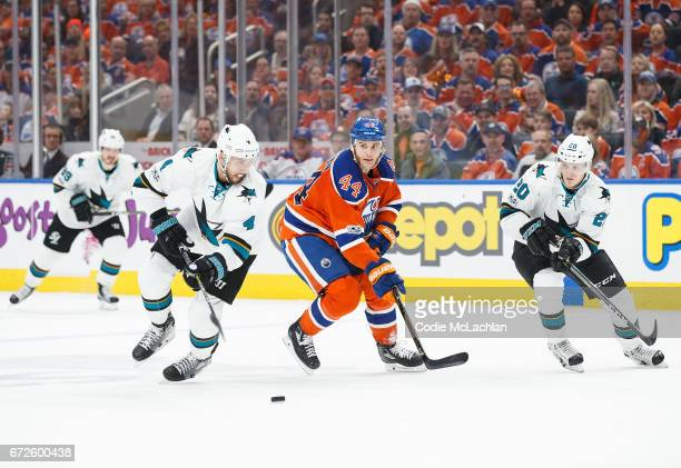 Zack Kassian of the Edmonton Oilers is hassled by Brenden Dillon and Marcus Sorensen of the San Jose Sharks in Game Five of the Western Conference...