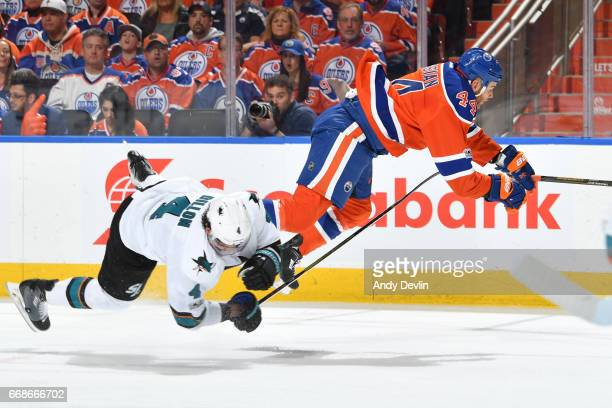 Zack Kassian of the Edmonton Oilers is tripped up by Brenden Dillon of the San Jose Sharks in Game Two of the Western Conference First Round during...