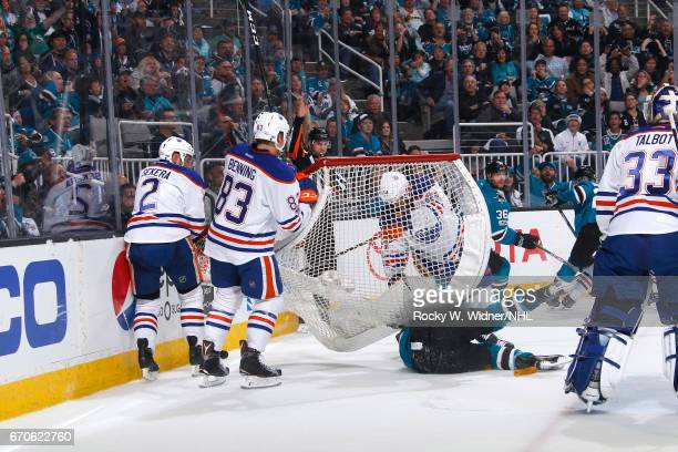Zack Kassian of the Edmonton Oilers runs into the net against the San Jose Sharks in Game Four of the Western Conference First Round during the 2017...