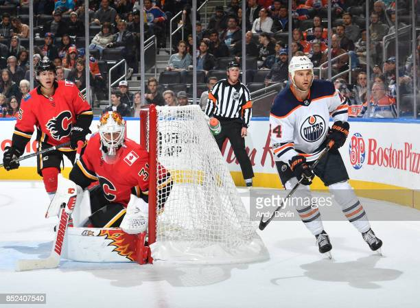 Zack Kassian of the Edmonton Oilers skates past Eddie Lack and Spencer Foo during the preseason game against the Calgary Flames on September 18 2017...