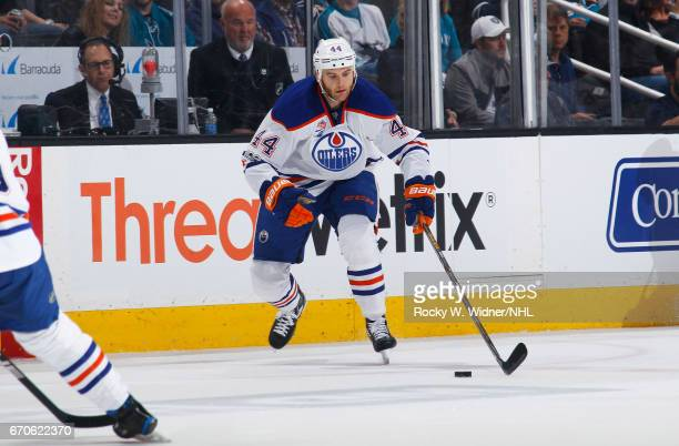 Zack Kassian of the Edmonton Oilers skates with the puck against the San Jose Sharks in Game Four of the Western Conference First Round during the...