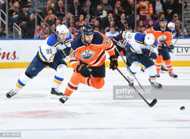 Zack Kassian of the Edmonton Oilers skates with the puck while being pursued by Vladimir Tarasenko of the St Louis Blues on November 16 2017 at...
