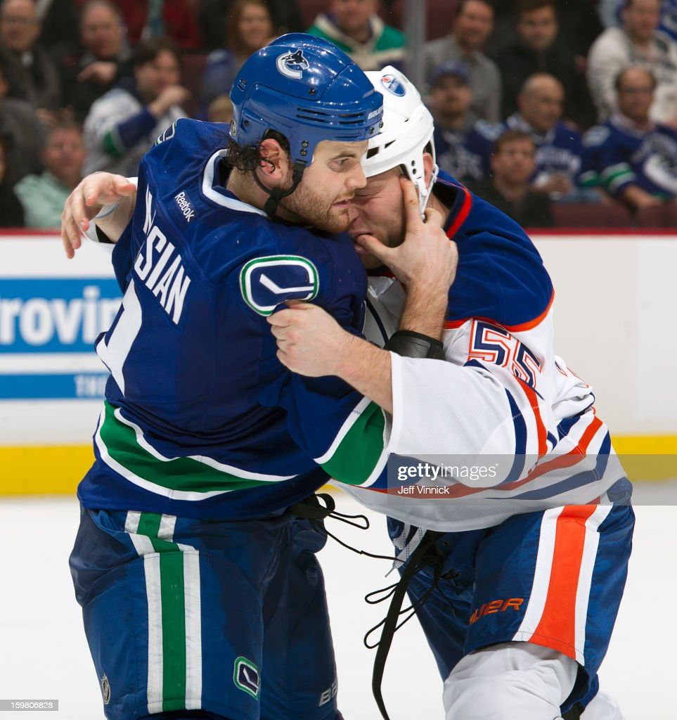 <a gi-track='captionPersonalityLinkClicked' href=/galleries/search?phrase=Zack+Kassian&family=editorial&specificpeople=4604939 ng-click='$event.stopPropagation()'>Zack Kassian</a> #9 of the Vancouver Canucks and <a gi-track='captionPersonalityLinkClicked' href=/galleries/search?phrase=Ben+Eager&family=editorial&specificpeople=570537 ng-click='$event.stopPropagation()'>Ben Eager</a> #55 of the Edmonton Oilers fight during their NHL game at Rogers Arena January 20, 2013 in Vancouver, British Columbia, Canada. Edmonton won 3-2 in a shootout.