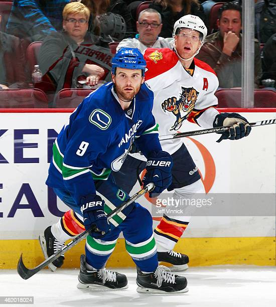 Zack Kassian of the Vancouver Canucks and Brian Campbell of the Florida Panthers skate up ice during their NHL game at Rogers Arena January 8 2015 in...