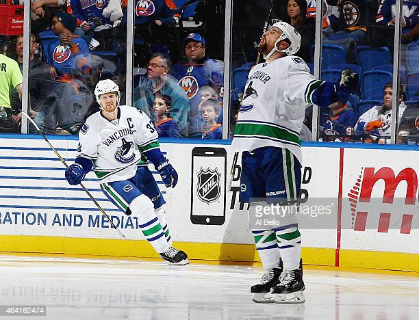 Zack Kassian of the Vancouver Canucks celebrates his goal with Henrik Sedin against the New York Islanders during their game at the Nassau Veterans...