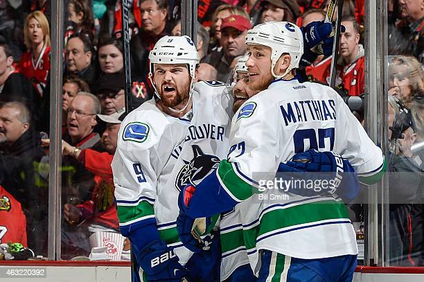 Zack Kassian of the Vancouver Canucks celebrates with Chris Higgins and Shawn Matthias after scoring against the Chicago Blackhawks in the second...