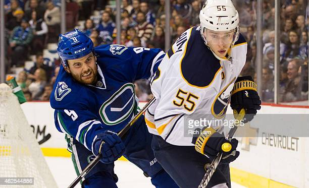 Zack Kassian of the Vancouver Canucks checks Rasmus Ristolainen of the Buffalo Sabres in NHL action on January 2015 at Rogers Arena in Vancouver...