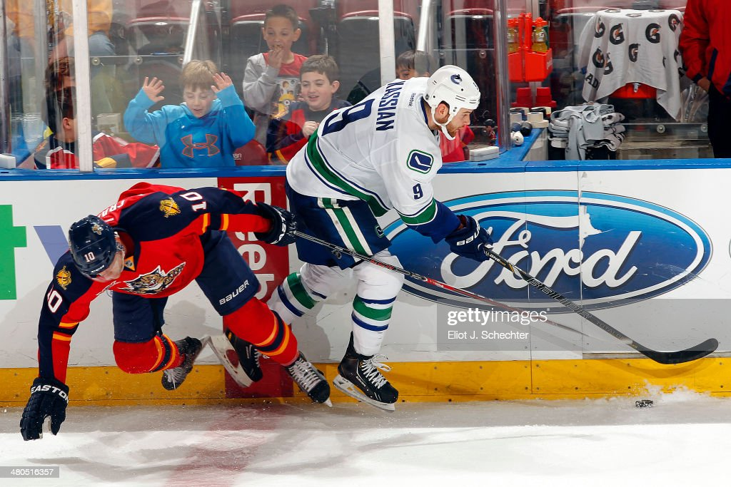 Zack Kassian of the Vancouver Canucks collides with Joey Crabb of the Florida Panthers at the BBT Center on March 16 2014 in Sunrise Florida
