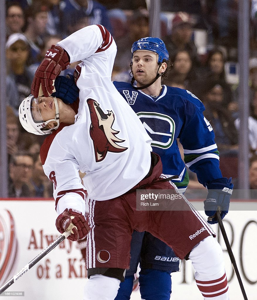 Zack Kassian #9 of the Vancouver Canucks grabs a hold of Rob Klinkhammer #36 of the Phoenix Coyotes during the second period in NHL action on April 08, 2013 at Rogers Arena in Vancouver, British Columbia, Canada. No penalty was called on the play.