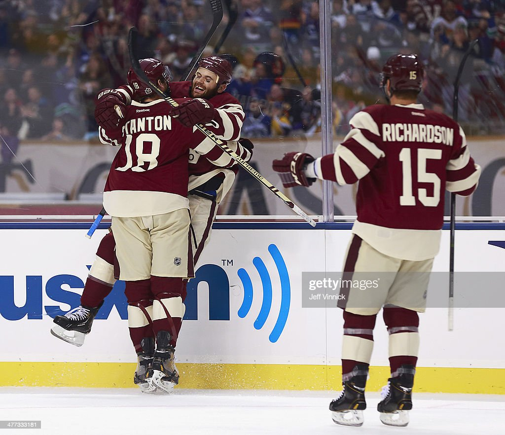 Zack Kassian of the Vancouver Canucks is congratulated by teammates Ryan Stanton and Brad Richardson after scoring during the 2014 Tim Hortons NHL...