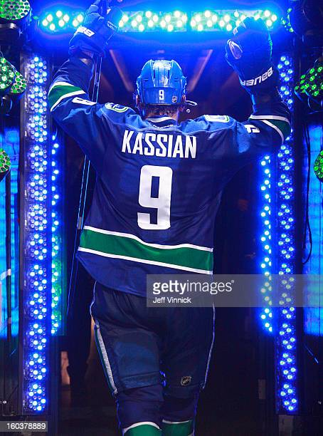 Zack Kassian of the Vancouver Canucks leaves the ice after their NHL game against the Calgary Flames at Rogers Arena January 23 2013 in Vancouver...