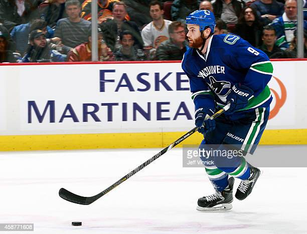 Zack Kassian of the Vancouver Canucks skates up ice with the puck during their NHL game against the Nashville Predators at Rogers Arena November 2...