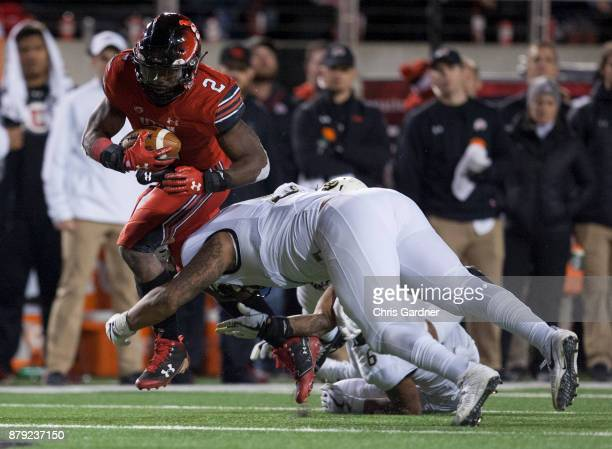 Zack Moss of the Utah Utes eludes a tackle attempt by George Frazier of the Colorado Buffaloes at RiceEccles Stadium on November 25 2017 in Salt Lake...