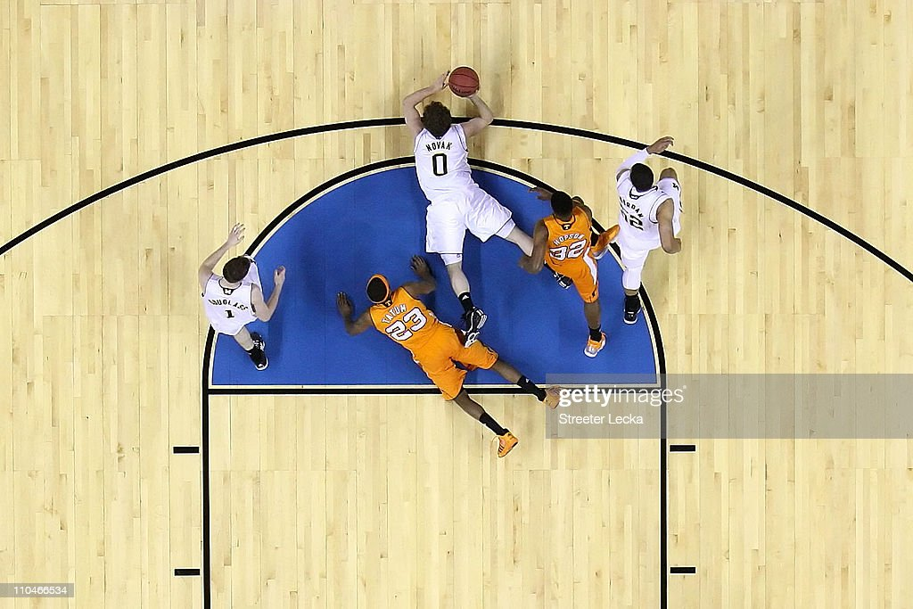 Zack Novak #0 of the Michigan Wolverines dives for the ball on the court in the first half while lying alongside <a gi-track='captionPersonalityLinkClicked' href=/galleries/search?phrase=Cameron+Tatum&family=editorial&specificpeople=4628288 ng-click='$event.stopPropagation()'>Cameron Tatum</a> #23 of the Tennessee Volunteers during the second round of the 2011 NCAA men's basketball tournament at Time Warner Cable Arena on March 18, 2011 in Charlotte, North Carolina.