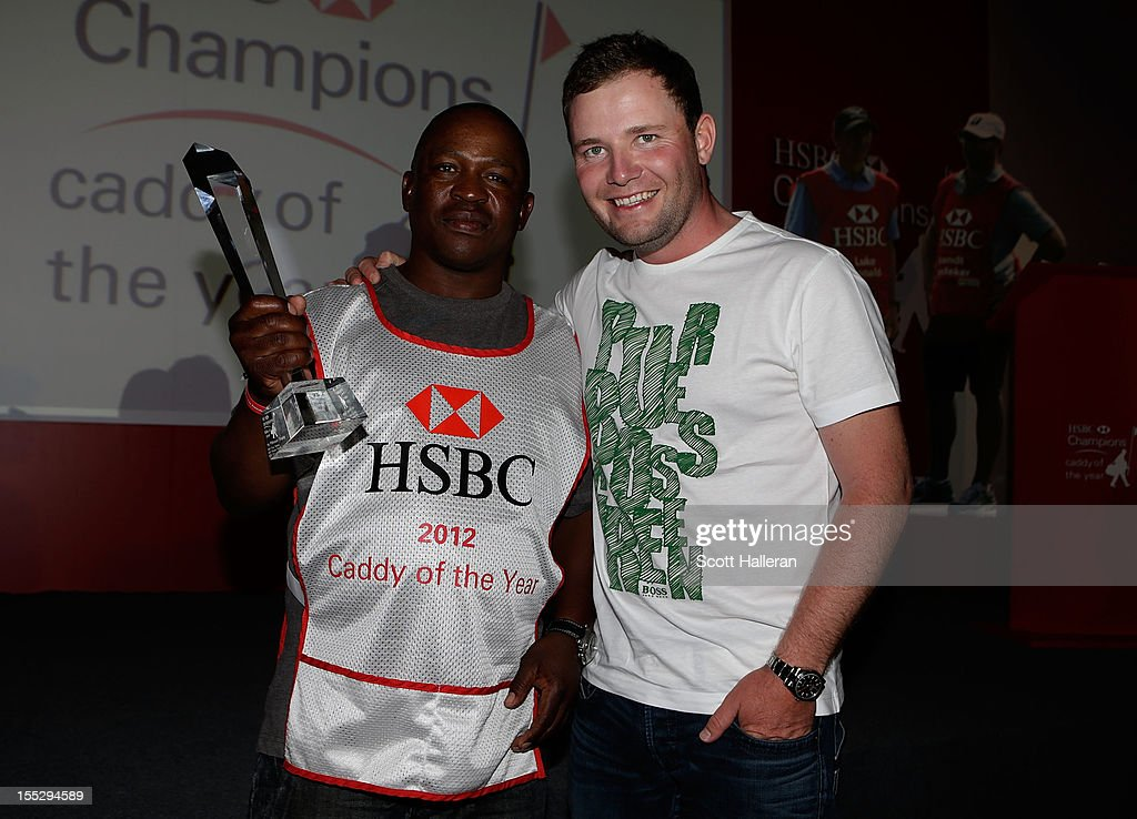 Zack Rasego poses with his Caddy of the Year award alongside his player <a gi-track='captionPersonalityLinkClicked' href=/galleries/search?phrase=Branden+Grace+-+Golfer&family=editorial&specificpeople=4816558 ng-click='$event.stopPropagation()'>Branden Grace</a> of South Africa at the WGC HSBC Champions at the Mission Hills Resort on November 2, 2012 in Shenzhen, China.