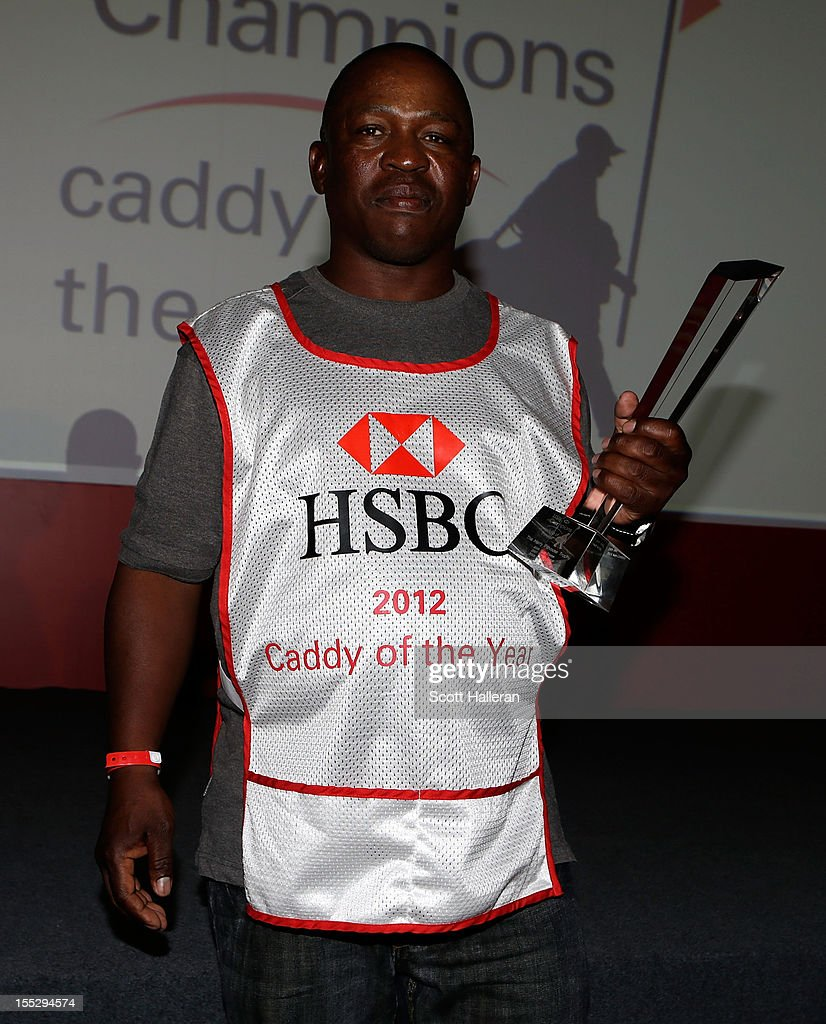 Zack Rasego poses with his Caddy of the Year award at the WGC HSBC Champions at the Mission Hills Resort on November 2, 2012 in Shenzhen, China.