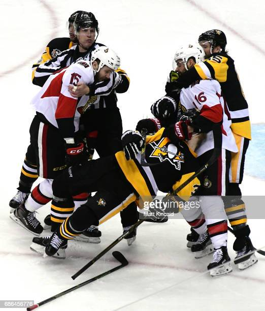 Zack Smith and Clarke MacArthur of the Ottawa Senators fight with Olli Maatta of the Pittsburgh Penguins during the third period in Game Five of the...
