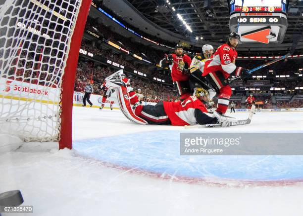 Zack Smith and Erik Karlsson of the Ottawa Senators look on as the gamewinning overtime goal by the Boston Bruins hits the back of the net behind...
