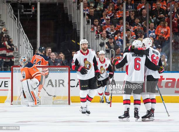 Zack Smith Chris Wideman and Mike Hoffman of the Ottawa Senators celebrate a goal against the Edmonton Oilers on October 14 2017 at Rogers Place in...