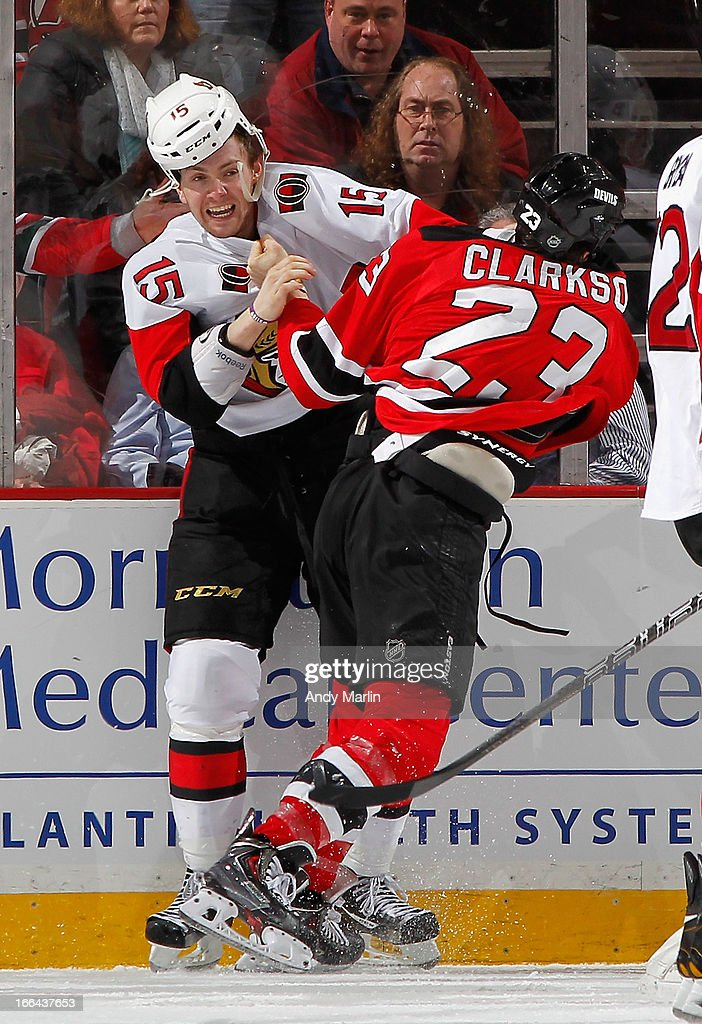 Zack Smith #15 of the Ottawa Senators and David Clarkson #23 of the New Jersey Devils tangle up as they fight during the game at the Prudential Center on April 13, 2013 in Newark, New Jersey.