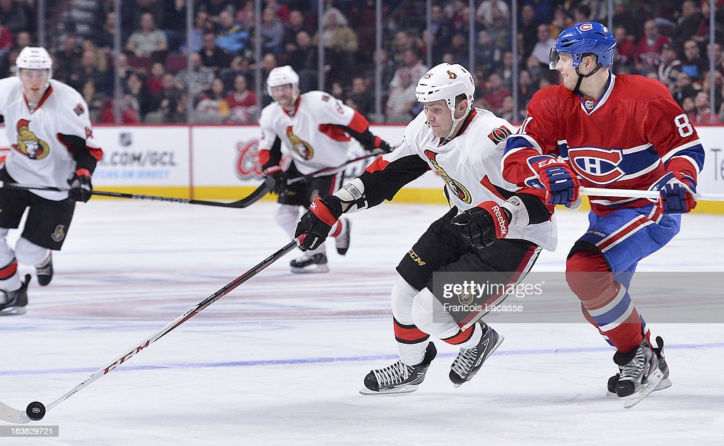 Zack Smith #15 of the Ottawa Senators attemps to skate the puck around <a gi-track='captionPersonalityLinkClicked' href=/galleries/search?phrase=Lars+Eller&family=editorial&specificpeople=4324947 ng-click='$event.stopPropagation()'>Lars Eller</a> #81 of the Montreal Canadiens during the NHL game on March 13, 2013 at the Bell Centre in Montreal, Quebec, Canada.