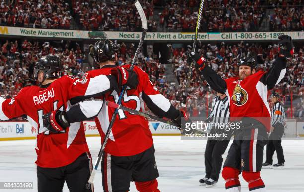 Zack Smith of the Ottawa Senators celebrates his first period goal with JeanGabriel Pageau and Marc Methot against the Pittsburgh Penguins in Game...