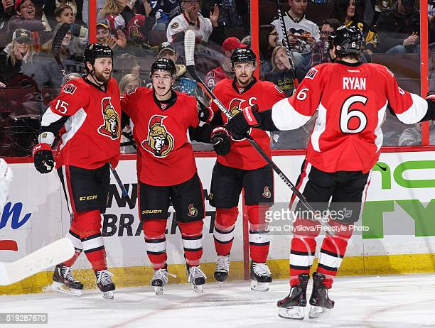 Zack Smith of the Ottawa Senators celebrates his second period goal against the Pittsburgh Penguins with team mates JeanGabriel Pageau Erik Karlsson...
