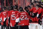 Zack Smith of the Ottawa Senators celebrates his third period goal with team mates Erik Condra Chris Phillips Jared Cowen and JeanGabriel Pageau...