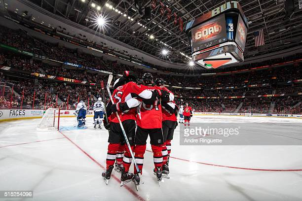 Zack Smith of the Ottawa Senators celebrates his third period goal against the Toronto Maple Leafs with teammate Mark Stone at Canadian Tire Centre...