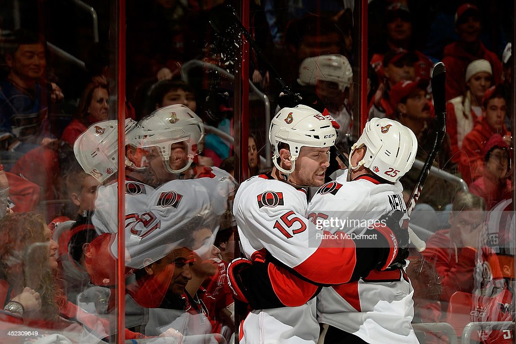 Zack Smith #15 of the Ottawa Senators celebrates with Chris Neil #25 after scoring a goal in the third period during an NHL game against the Washington Capitals at Verizon Center on November 27, 2013 in Washington, DC.