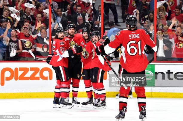 Zack Smith of the Ottawa Senators celebrates with his teammates after scoring a goal against MarcAndre Fleury of the Pittsburgh Penguins during the...