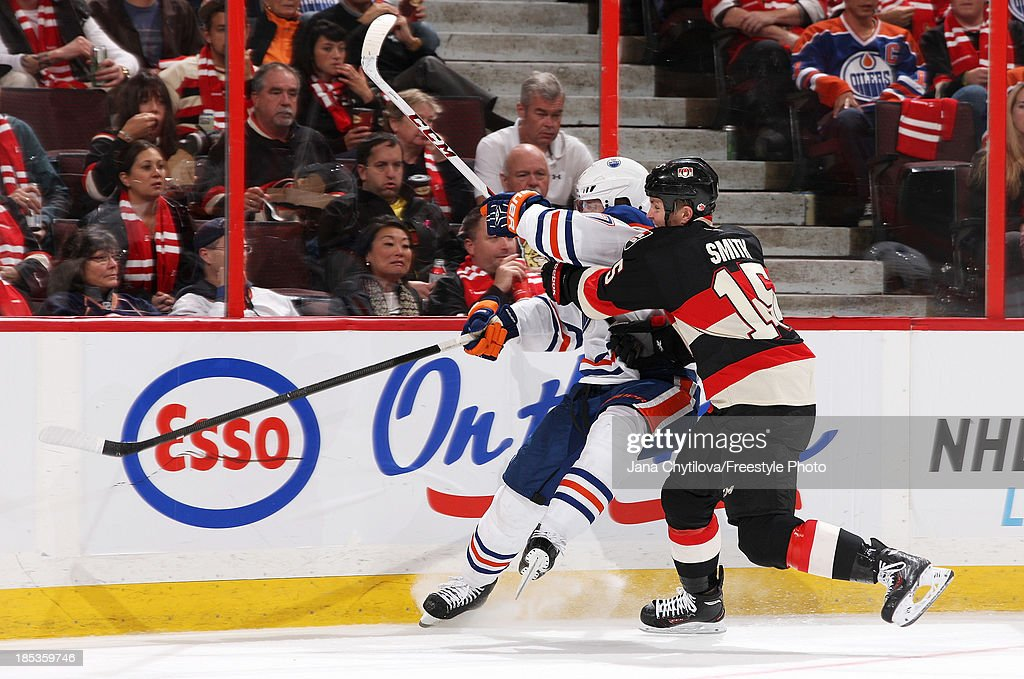 Zack Smith #15 of the Ottawa Senators checks <a gi-track='captionPersonalityLinkClicked' href=/galleries/search?phrase=Anton+Belov&family=editorial&specificpeople=4628750 ng-click='$event.stopPropagation()'>Anton Belov</a> #77 of the Edmonton Oilers during an NHL game at Canadian Tire Centre on October 19, 2012 in Ottawa, Ontario, Canada.