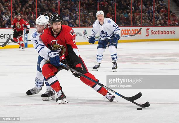 Zack Smith of the Ottawa Senators controls the puck against Matt Hunwick of the Toronto Maple Leafs at Canadian Tire Centre on February 6 2016 in...