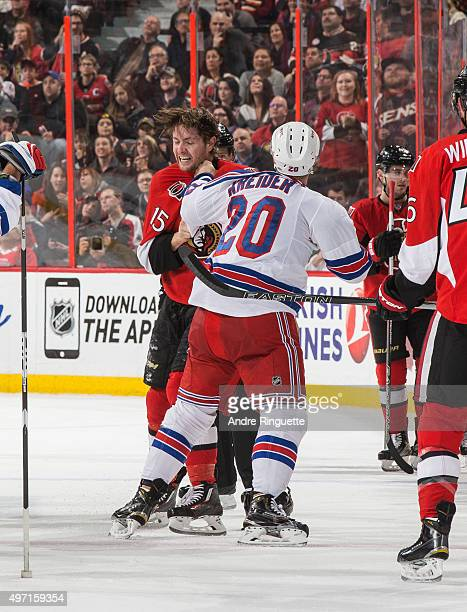 Zack Smith of the Ottawa Senators fights with Chris Kreider of the New York Rangers during the second period of an NHL game at Canadian Tire Centre...