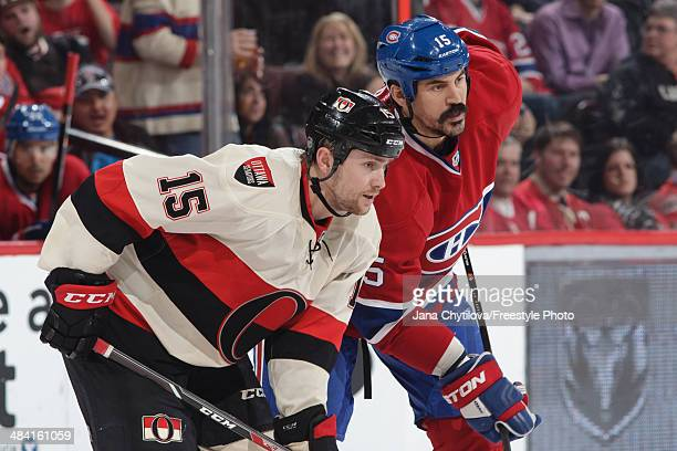 Zack Smith of the Ottawa Senators prepares for a faceoff against George Parros of the Montreal Canadiens during an NHL game at Canadian Tire Centre...