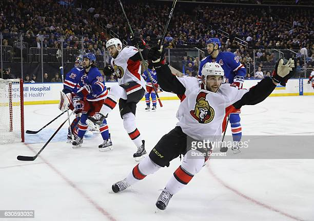 Zack Smith of the Ottawa Senators scores at 310 of the first period against Antti Raanta of the New York Rangers as Derick Brassard joins the...